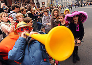 PHILADELPHIA - JANUARY 1: Alex Leicht, 10, of Devon, Pennsylvania tutes a horn while watching the 2011 Mummers Parade in Philadelphia, Pennsylvania. Thousands of people enjoyed the warmer weather and watched the parade, which has been around for over 100 years. (Photo by William Thomas Cain/Getty Images)