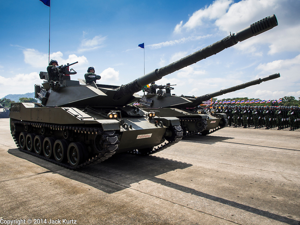 29 SEPTEMBER 2014 - NAKHON NAYOK, NAKHON NAYOK, THAILAND: Royal Thai Army tanks parade past the reviewing stand at the retirement ceremony for more than 200 Thai generals including Gen. Prayuth Chan-ocha, who led the 22 May coup against the civilian government earlier this year. Prayuth has been chief of the Thai army since 2010. After his retirement, Gen. Prayuth will retain his posts as head of the junta's National Council for Peace and Order (NCPO) and Prime Minister of Thailand. Under Thai law, military officers must retire at 60 years of age. The 200 generals who retired with Prayuth were also his classmates at the Chulalomklao Royal Military Academy in Nakhon Nayok.    PHOTO BY JACK KURTZ