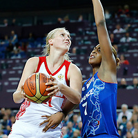 09 August 2012: Russia Irina Osipova goes to the basket against Sandrine Gruda during 81-64 Team France victory over Team Russia, during the women's basketball semi-finals, at the 02 Arena, in London, Great Britain.