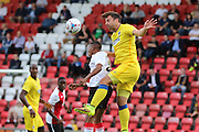 AFC Wimbledon midfielder Chris Whelpdale (11) jumps with Woking midfilder Charles Banya during the Pre-Season Friendly match between Woking and AFC Wimbledon at the Kingfield Stadium, Woking, United Kingdom on 29 July 2016. Photo by Stuart Butcher.