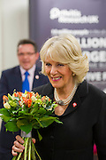 Her Royal Highness meets other staff and supporters and is given flowers.The Duchess of Cornwall, Patron, Arthritis Research UK, visits and meets patients of the Adolescent Inpatient Unit at University College London Hospitals.  •Her Royal Highness then tours a laboratory at the Arthritis Research UK Centre for Adolescent Rheumatology and meeting researchers and supporters. London 12 Feb 2015.