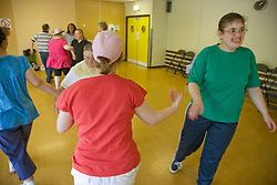 Group of Day Service users with learning disability enjoying a line dancing class,