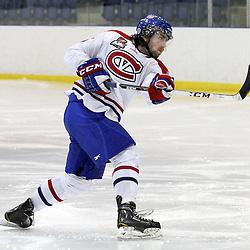 KINGSTON,ON-Jan 30 :<br />  Ontario Junior Hockey League, Regular season game between Kingston Voyageurs and Mississauga Chargers. Jarret Kup #25 of the Kingston Voyageurs Hockey Club. (Photo by Robert John Boucher / OJHL Images)