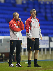 READING, ENGLAND - Wednesday, March 12, 2014: Liverpool's manager Neil Critchley and Mike Garrity during the FA Youth Cup Quarter-Final match against Reading at the Madejski Stadium. (Pic by David Rawcliffe/Propaganda)