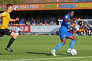 AFC Wimbledon attacker Michael Folivi (17) dribbling into box during the EFL Sky Bet League 1 match between AFC Wimbledon and Bristol Rovers at the Cherry Red Records Stadium, Kingston, England on 21 September 2019.