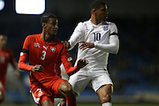 Martin Angha, Swiss U21 International AND Ruben Loftus-Cheek (Chelsea), England U21 during the UEFA European Championship Under 21 2017 Qualifier match between England and Switzerland at the American Express Community Stadium, Brighton and Hove, England on 16 November 2015.