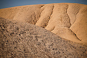 Contrasting sediment badlands at Zabriskie Point in Death Valley National Park, Nevada, USA. Zabriskie point was once the home of twenty-mule team borax mines.