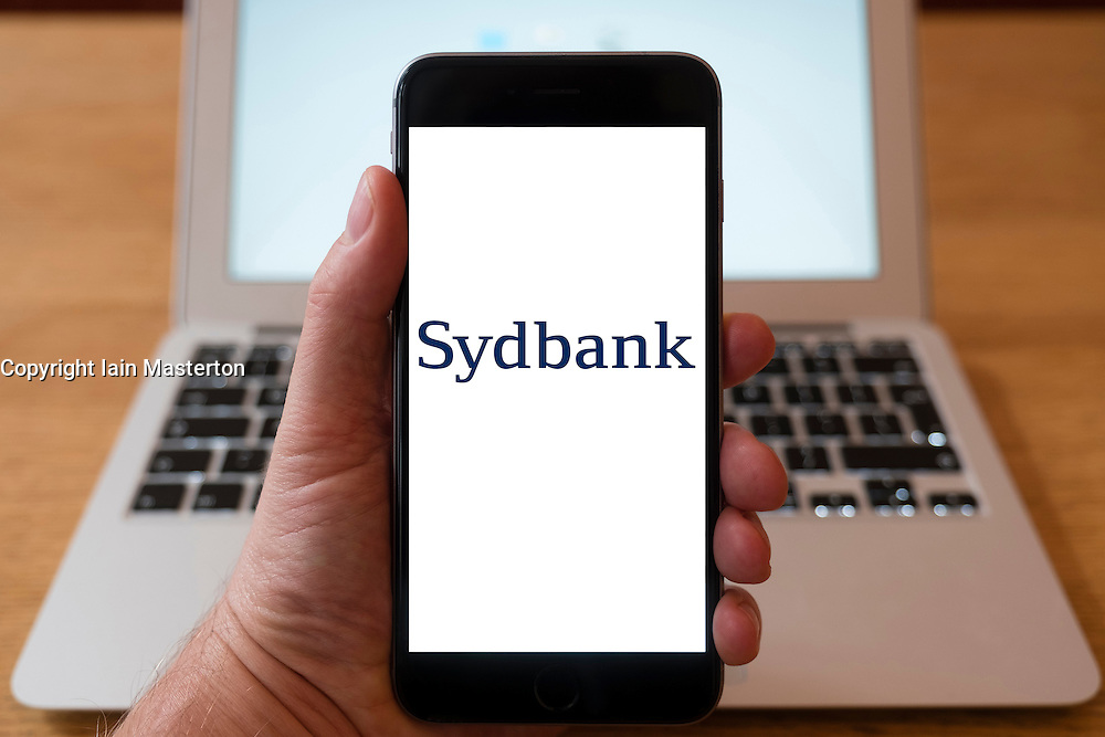 Using iPhone smart phone to display website logo of Sydbank, Danish bank