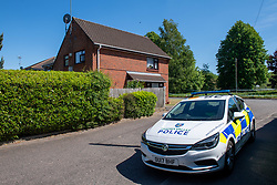 © Licensed to London News Pictures. 21/05/2020. Beaconsfield, UK. A police car sits outside a property on North Drive. Thames Valley Police were called to North Drive, Beaconsfield at around 00:01 BST on Thursday 21/05/2020 to a report of a stabbing. A man in his forties had sustained injuries consistent with stab wounds and was taken to hospital. Photo credit: Peter Manning/LNP