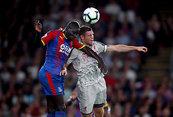 Crystal Palace's Mamadou Sakho (left) and Liverpool's James Milner battle for the ball in the air during the Premier League match at Selhurst Park, London.