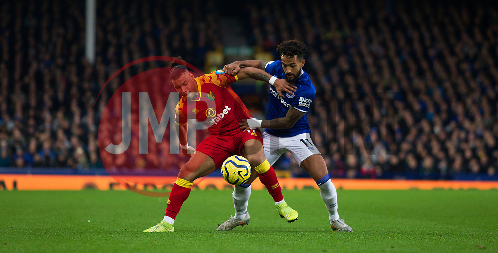 Theo Walcott of Everton (R) is tackled by Onel Hernandez of Norwich City - Mandatory by-line: Jack Phillips/JMP - 23/11/2019 - FOOTBALL - Goodison Park - Liverpool, England - Everton v Norwich City - English Premier League