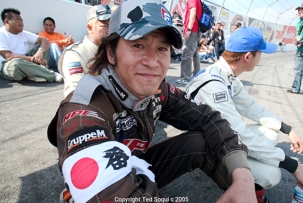 A Japanese Drift car driver..Drift racing visits Irwindale Motor Speedway. Drift racing originated in Japan and is becoming very popular in the USA. The drivers are rated on their driving style. They must maintain control of their cars while driving them in a constant state of skid/burnout at around 100mph on a road course track. The cars are production cars with some modifications and are usually street legal..Irwindale Motor Speedway, CA USA .2/27/05.Photo by Ted Soqui c 2005