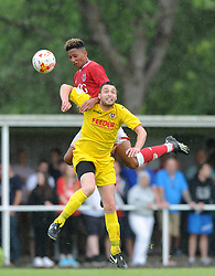 Lloyd Kelly of Bristol City challenges for a header during a community match against Brislington FC - Photo mandatory by-line: Dougie Allward/JMP - Mobile: 07966 386802 - 05/07/2015 - SPORT - Football - Bristol - Brislington Stadium - Pre-Season Friendly