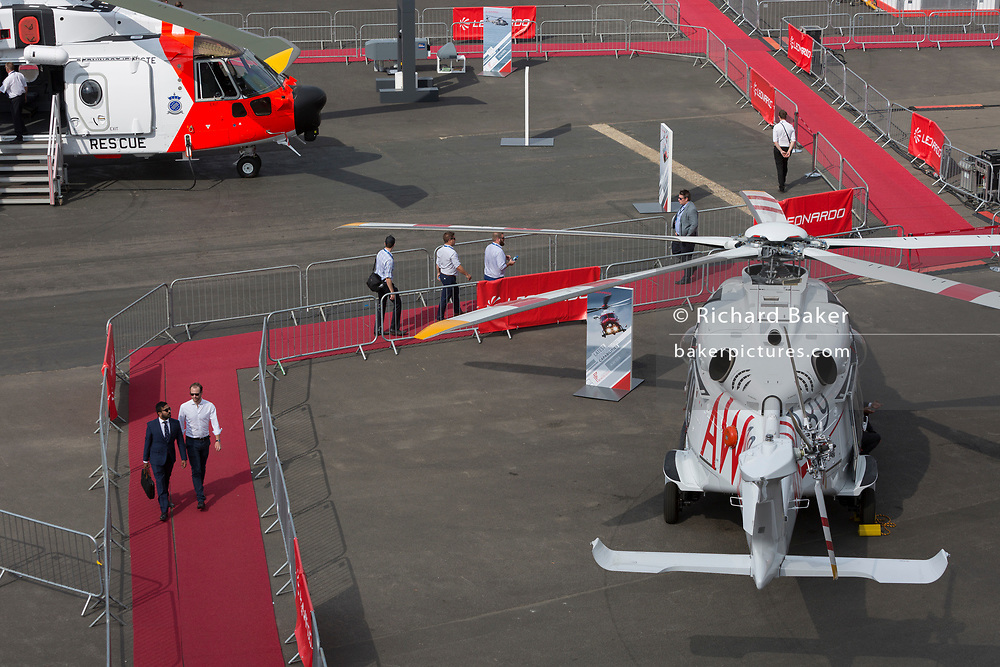 Visitors on the red carpet at the Leonardo (formerly Finmeccanica) exhibition stand at the Farnborough Airshow, on 16th July 2018, in Farnborough, England.