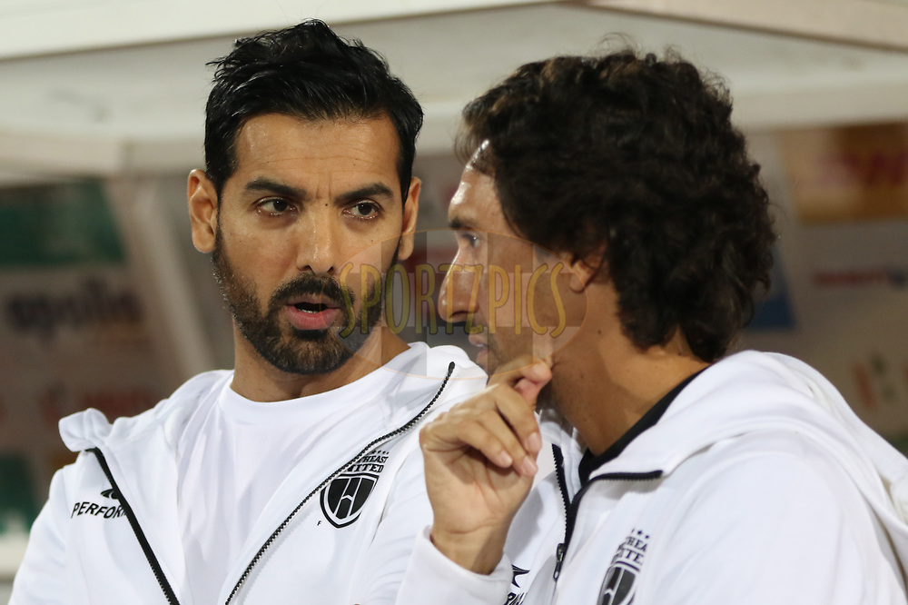 NorthEast United FC coowner John(L) with coach Joao Carlos Pires de Deus during match 19 of the Hero Indian Super League between NorthEast United FC and Bengaluru FC held at the Indira Gandhi Athletic Stadium, Guwahati India on the 8th December 2017<br /> <br /> Photo by: Saikat Das  / ISL / SPORTZPICS