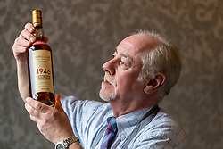 Auction house, Bonham's, will be holding a sale of rare whisky on 7 March 2018 at 11am. <br /> <br /> The sale includes two rare whiskies; a bottle of the Macallan Select Reserve 52 year-old 1946, bottled in May 1998. It is estimated at £12,000-14,000 and a bottle of Black Bowmore 1964, bottled in 1994, and estimated at £8,000-10,000. <br /> <br /> The 1946 Macallan was produced in an unusual way. Coal was scarce and expensive immediate after World War II, so the malt was dried in peat-fired kilns instead resulting in a whisky with distinct and complex tastes and aromas.<br /> <br /> Pictured: Danny McIlwraith of Bonhams with the Macallan 1946