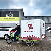 Nederland, Roermond, 10 februari 2016.<br /> Cityhub stadsdistributie in Roermond.<br /> Yourick Fokker en compagnon(operations en stores) van Cityhub  met elektrische bakfiets <br /> <br /> Environmental friendly electric powered logistics by Cityhub in Roermond, the Netherlands. <br /> <br /> <br /> Foto: Jean-Pierre Jans