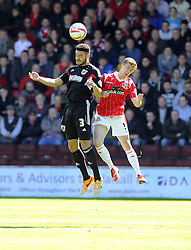 Bristol City's Derrick Williams battles for the high ball with Walsall's James Baxendale  - Photo mandatory by-line: Joe Meredith/JMP - Mobile: 07966 386802 12/04/2014 - SPORT - FOOTBALL - Walsall - Banks' Stadium - Walsall v Bristol City - Sky Bet League One