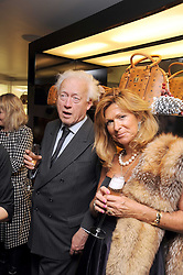 LORD MOYNE and EINA BOND at the MCM Christmas party held at their store at 5 Sloane Street, London on 26th November 2008.