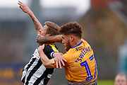 Notts County forward Jonathan Stead (30) challenges with Mansfield Town defender Ryan Sweeney (17), on loan from Stoke City,  during the EFL Sky Bet League 2 match between Mansfield Town and Notts County at the One Call Stadium, Mansfield, England on 8 December 2018.