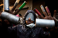 "November 22, 2011 – Cairo, Egypt - A protestor holds up ammunition used by the police in Tahrir square. Protest organizers called for a ""million man march,"" thousands turned out. Egypt's military leader promised a faster transition to civilian rule, saying Tuesday that presidential elections will be held by the end of June 2012. But the major concession was immediately rejected by tens of thousands of protesters in Cairo's Tahrir Square who responded with chants of ""leave, leave"" now. Photo credit: Trevor Snapp"