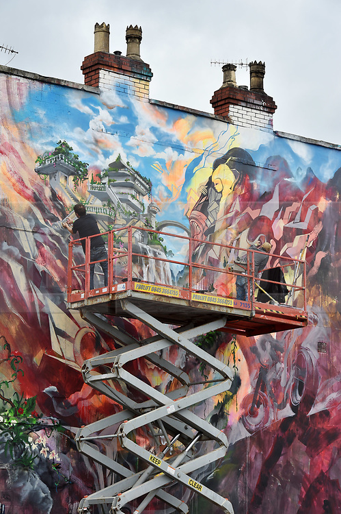 © Licensed to London News Pictures.  29/07/2017; Bristol, UK. Upfest 2017. A giant mural in progress created by artists Will Barrass and Xenz on the side of the Masonic for Upfest, Europe's largest street art festival held annually in Bedminster, Bristol. The festival officially runs from 29 - 31 July with over 350 artists live painting in 37 locations including this Ashton Gate stadium, home of Bristol City FC. Picture credit : Simon Chapman/LNP