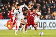 Marvin Johnson (21) of Middlesbrough goes down after being challenged by Ben Cabango (44) of Swansea City during the EFL Sky Bet Championship match between Swansea City and Middlesbrough at the Liberty Stadium, Swansea, Wales on 14 December 2019.