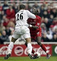 Photo. Aidan Ellis.Digitalsport<br /> Middlesbrough v Bolton Wanderers.<br /> FA Barclaycard Premiership.<br /> 03/04/2004.<br /> Boro's Jopseph-Desire Job and Bolton's Emerson Thome