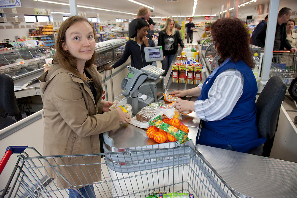 Astrid Holmann and her son Lenard (not in photo) in Hamburg, Germany shopping in the Aldi supermarket. They were photographed for the Hungry Planet: What I Eat project with a week's worth of food in June. Model Released.
