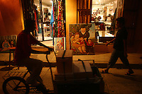 """Replicas of paintings by Fernando Botero are for sale to visitors in the """"Old City"""" in Cartagena, a unique travel destination on Colombia's Caribbean coast. (Photo/Scott Dalton)"""