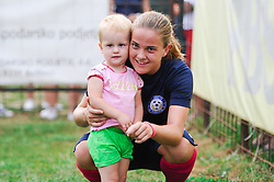 A player of ZNK Pomurje and a fan during the UEFA Women's Champions League Qualifying Match between ZNK Teleing Pomurje (SLO) and Olimpia Cluj (ROU) at Sportni Park on August 16, 2015 in Beltinci, Slovenia. Photo by Mario Horvat / Sportida