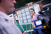Research and Creative Activity Fair : May 14, 2009 at the Convo..Patrick Henderson WOUB taping Ant-Cancer drug research with   Haley Bowers(purple shirt)