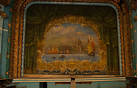 The stage curtain hangs from the stage at the Colonial Theater in Laconia.  Karen Bobotas for the Laconia Daily Sun