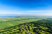 Nederland, Noord-Holland, Purmerend, 13-06-2017; Polder De Purmer gezien naar Monnickendam en IJsselmeer. Purmerbos met golfbaan on de voorgrond. Gouwzee en Marken aan de verre horizon.<br /> Polder Purmer.<br /> luchtfoto (toeslag op standaard tarieven);<br /> aerial photo (additional fee required);<br /> copyright foto/photo Siebe Swart