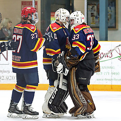 TRENTON, ON  - FEB 23,  2018: Ontario Junior Hockey League game between the Trenton Golden Hawks and the Wellington Dukes, Mitchell Mendonca #27 of the Wellington Dukes, Jonah Capriotti #30 of the Wellington Dukes and Tyler Richardson #33 of the Wellington Dukes celebrates the win. <br /> (Photo by Ed McPherson / OJHL Images)