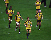 Hurricanes captain Tamati Ellison (centre) leads his team onto the pitch, including (from left) Victor Vito, Jason Kawau and Scott Waldrom.<br /> Super 14 rugby union match, Hurricanes v Highlanders, Westpac Stadium, Wellington, New Zealand. Friday 20 February 2009. Photo: Dave Lintott/PHOTOSPORT
