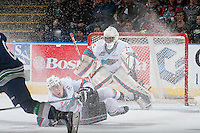 KELOWNA, CANADA - FEBRUARY 8: Rodney Southam #17 tries to block a shot on Michael Herringer #30 of Kelowna Rockets on February 8, 2016 at Prospera Place in Kelowna, British Columbia, Canada.  (Photo by Marissa Baecker/Shoot the Breeze)  *** Local Caption *** Rodney Southam; Michael Herringer;