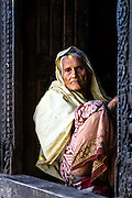 An elderly woman at the Pashupatinath Elderly Home in Kathmandu, Nepal.