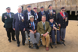 © Licensed to London News Pictures. 06/06/2017. Normandy, France. Former leader of UKIP, NIGEL FARAGE stands with a group of WW2 veterans, during a visit to Arromanches Beach in Normandy, France to mark the anniversary of the D-Day landings on June 1944.. Photo credit: Jason Bryant/LNP