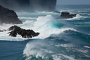 Unusually powerful and large waves wash against the sea cliffs of Espanola Island, Galapagos Archipelago - Ecuador.