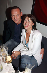 Actor PERRY FENWICK and actress ANGELA LONSDALE at a party to celebrate the publication of The Man Who Fell in Love With His Wife by Paul Burke held at The Groucho Club, 45 Dean Street, London W1 on 12th July 2004.