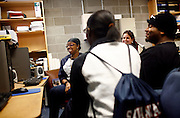 Students Monét Murphy (left to right), 19, Kardesha Hickman, 18, Christy Pavel, 25, and Michael Knowles laugh over MadTV clips on YouTube clips in a computer lab at Savannah State University before their Intro to Marine Science class in Savannah, Georgia February 9, 2009. KENDRICK BRINSON