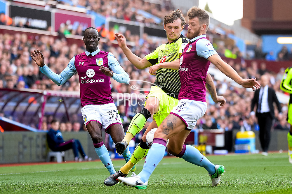 Reading midfielder John Swift (8) battles for possession with Aston Villa defender Nathan Baker (2) during the EFL Sky Bet Championship match between Aston Villa and Reading at Villa Park, Birmingham, England on 15 April 2017. Photo by Dennis Goodwin.