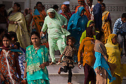 Visitors are walking outside from the Taj Mahal main tombs area, in Agra.
