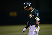 Oakland Athletics left fielder Khris Davis (2) reacts to being tagged out at first base against the San Francisco Giants at Oakland Coliseum in Oakland, California, on August 1, 2017. (Stan Olszewski/Special to S.F. Examiner)