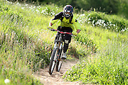 SHOT 7/28/11 5:14:59 PM - A mountain biker makes his way down a trail while riding in the Trestle Bike Park in Winter Park, Co. Featuring 37 miles of downhill trails accessed from three different chairlifts and over 200 features, the park offers programs for beginners to experts. (Photo by Marc Piscotty / © 2011)