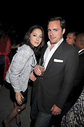 Jackie Fast and HENRY DEEDES at the Quintessentially and Perrier-Jouet Belle Epoque Summer Party in association with Jaguar held at The Orangery, Kensington Palace, London on 18th June 2009.