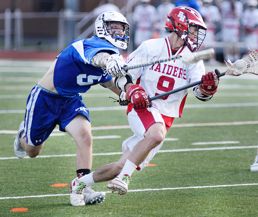 Rondout Valley's Keith Malak, left, tries to knock the  ball away from Red Hook's Onam Guerra during the Section 9 Class C boys' lacrosse championship game at Dietz Stadium in Kingston on Friday, May 25, 2012.