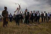 Vice President Joe Biden and Mongolian Prime Minister Sukhbaatar Batbold try out their archery during a cultural demonstration in Ulaanbataar, Mongolia, August 22, 2011. <br /> (Official White House Photo by David Lienemann)