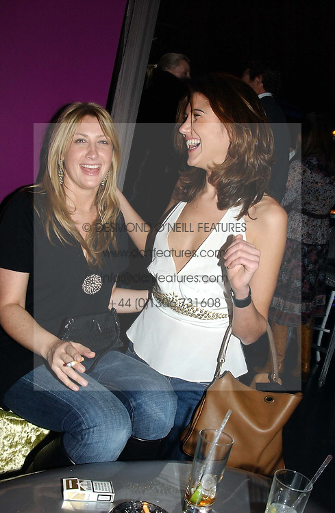Left to right, MISS GEORGINA COHEN and MISS GABRIELA RELJANOVIC at a party hosted by Panerai and the Baglioni Hotel, 60 Hyde Park Gate, London on 6th December 2004.<br /><br />NON EXCLUSIVE - WORLD RIGHTS